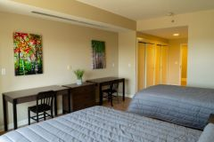 Our double bedrooms include two desks, a restroom, and closets for easy organization.
